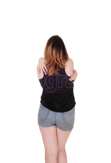 Young woman standing from back in shorts