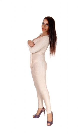 Young woman standing in silver body suit