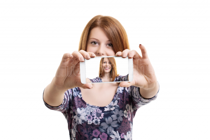 Young woman taking a selfie with a smartphone