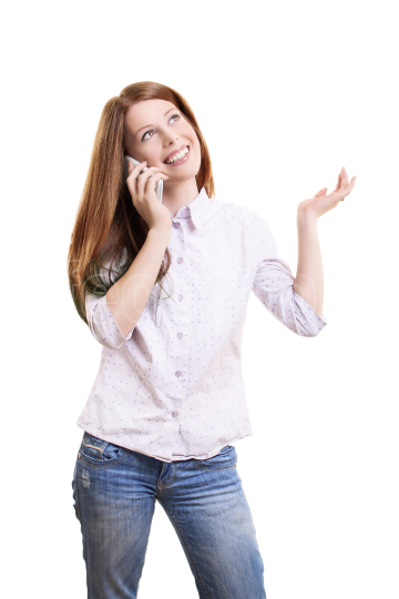 Young woman talking on a phone and gesturing with one hand