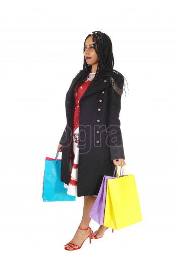 Young woman walking with shopping bag s